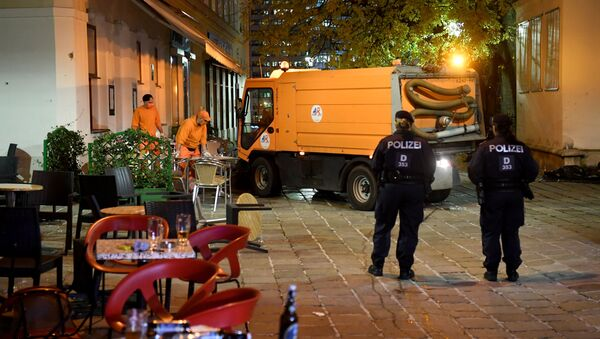 Hastily left drinks are seen on a table as cleaning crews and police work outside a restaurant near the scene of an attack in Vienna, Austria on November 3, 2020, one day after a shooting at multiple locations across central Vienna.  - Sputnik International