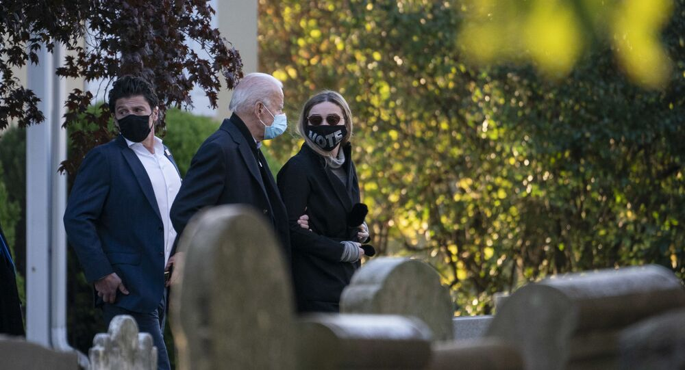 Democratic presidential nominee Joe Biden walks with his granddaughter Finnegan Biden as they arrive at St. Joseph on the Brandywine Roman Catholic Church for mass on the morning of November 03, 2020 in Wilmington, Delaware.