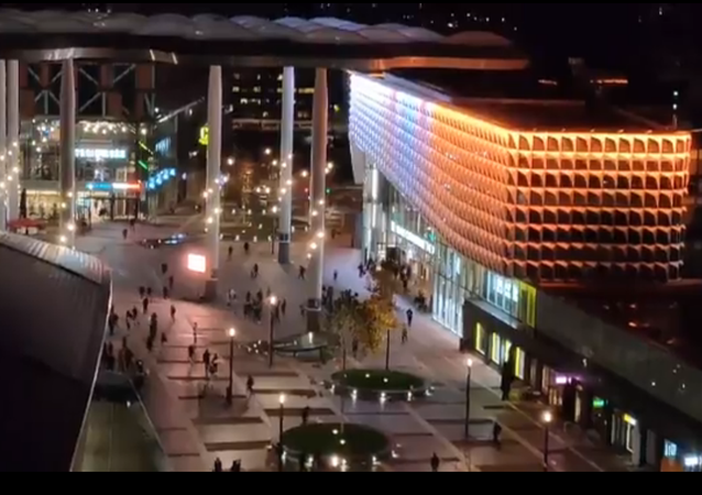 Screenshot from the video showing travellers waiting outside the Utrecht rail station after it was evacuated due to suspicios situation