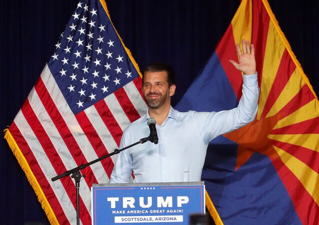 Donald Trump Jr. gestures during a campaign rally for U.S. President Donald Trump ahead of Election Day, in Scottsdale