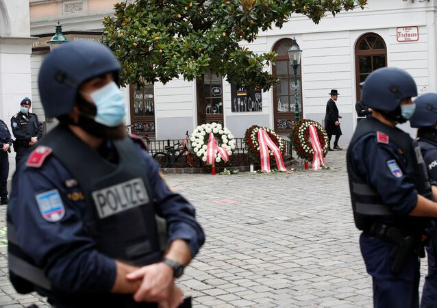 Police officers stand guard at the site of a wreath laying ceremony after a gun attack in Vienna, 3 November 2020.