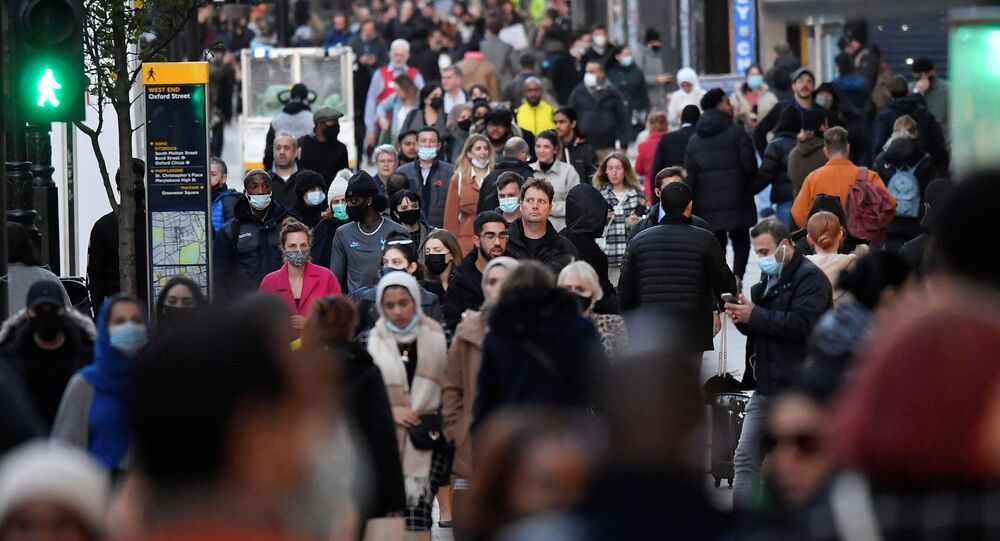 Shoppers walk after new nationwide restrictions were announced during the coronavirus disease (COVID-19) outbreak in Oxford Street, London, Britain, November 2, 2020.