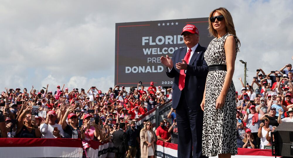 U.S. President Donald Trump applauds next to first lady Melania Trump his campaign rally outside Raymond James Stadium, in Tampa, Florida, U.S., October 29, 2020
