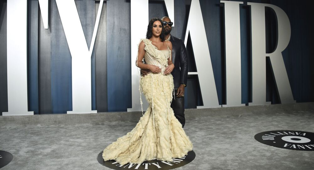 Kim Kardashian, left, and Kanye West arrive at the Vanity Fair Oscar Party on Sunday, Feb. 9, 2020, in Beverly Hills, Calif.