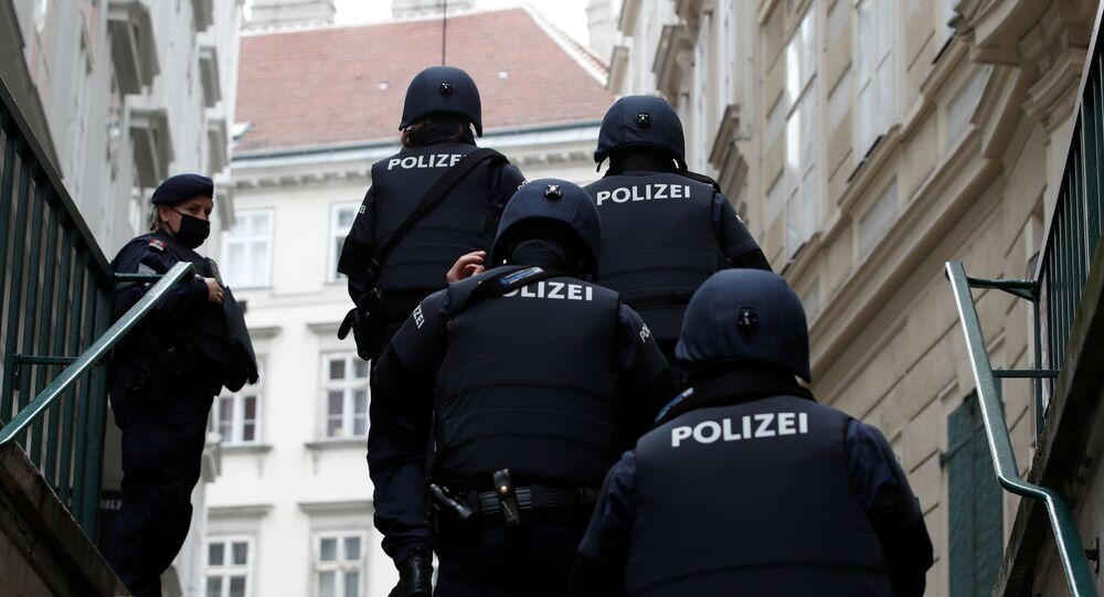Police officers walk after exchanges of gunfire in Vienna, Austria November 3, 2020.