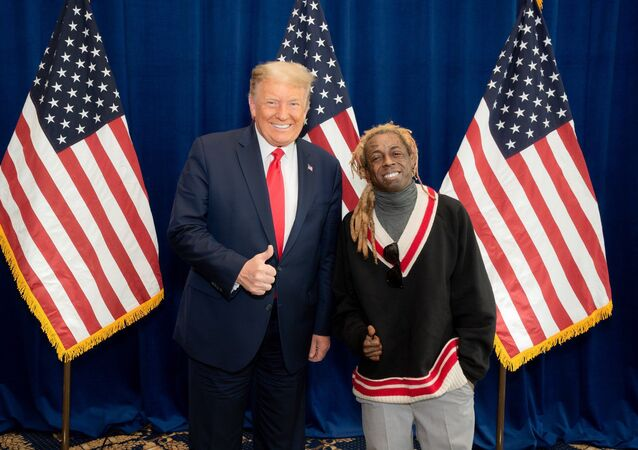American rapper Lil Wayne poses for a photo with US President Donald Trump at the president's resort in Doral, Florida, on 29 October.