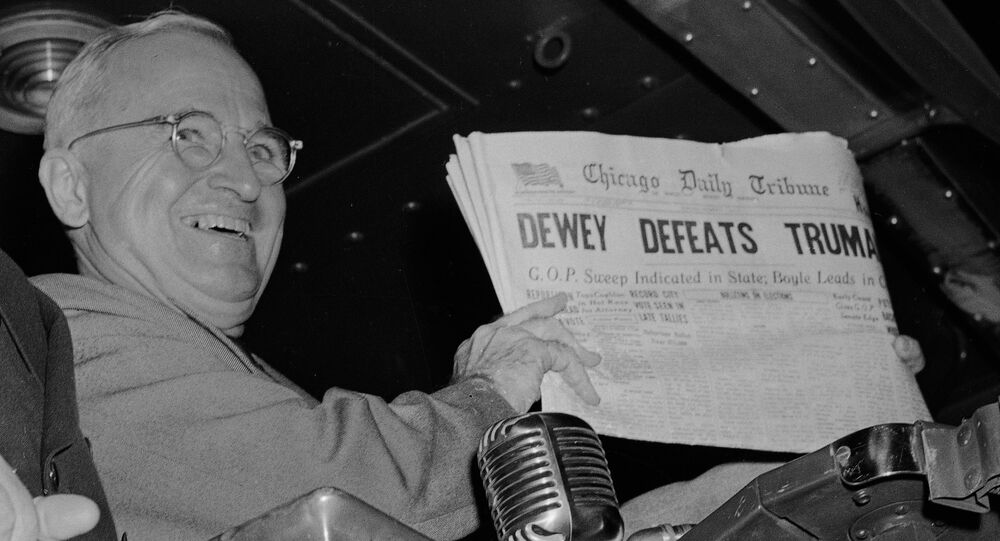 US President Harry S. Truman holds up an early edition of the Chicago Daily Tribune which wrongly reported he had lost the 1948 election.