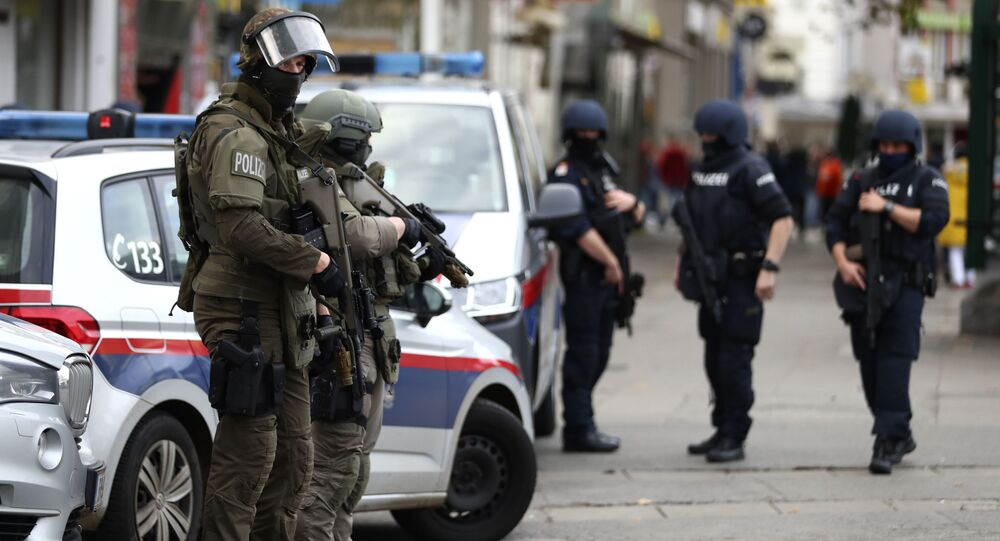 Police officers guard the scene in Vienna, Austria, Tuesday, 3 November 2020