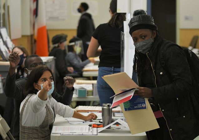 A woman prepares to vote at a polling station in New York.