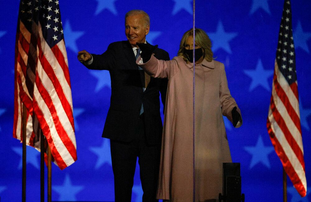 US Democrat presidential nominee and former vice-president Joe Biden, accompanied by his wife Jill, points a finger as he delivers remarks after early results from the 2020 presidential election in Wilmington, Delaware, US, 4 November 2020.