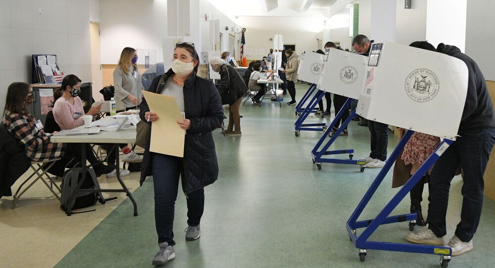 Voters cast their ballots in US presidential election on 3 November 2020