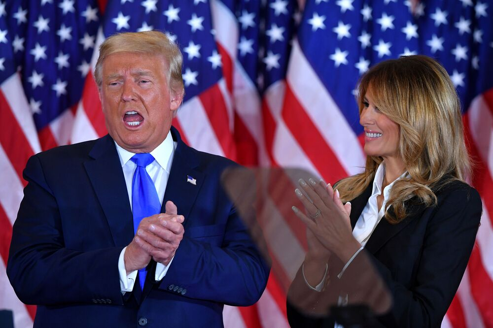 US President Donald Trump claps alongside First Lady Melania Trump after speaking during election night in the East Room of the White House in Washington, DC, early on 4 November 2020.