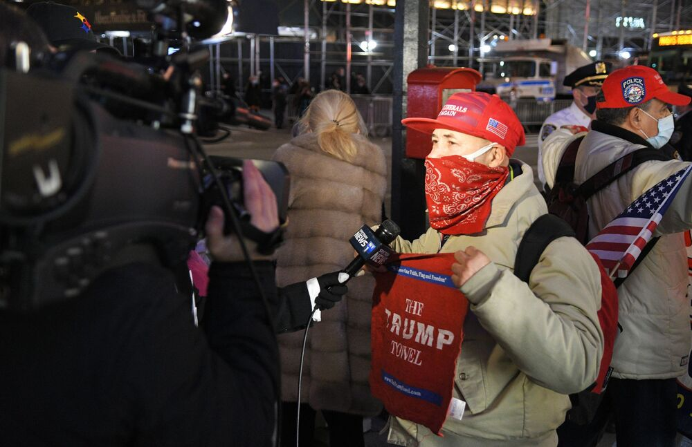 Trump supporter talks to journalists near the Trump Tower in New York City on Election Day.
