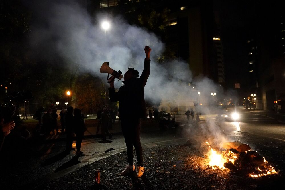A protester yells after a march to the Mark O Hatfield United States Courthouse on the night of the election, in Portland, Oregon, Tuesday 3 November 2020.