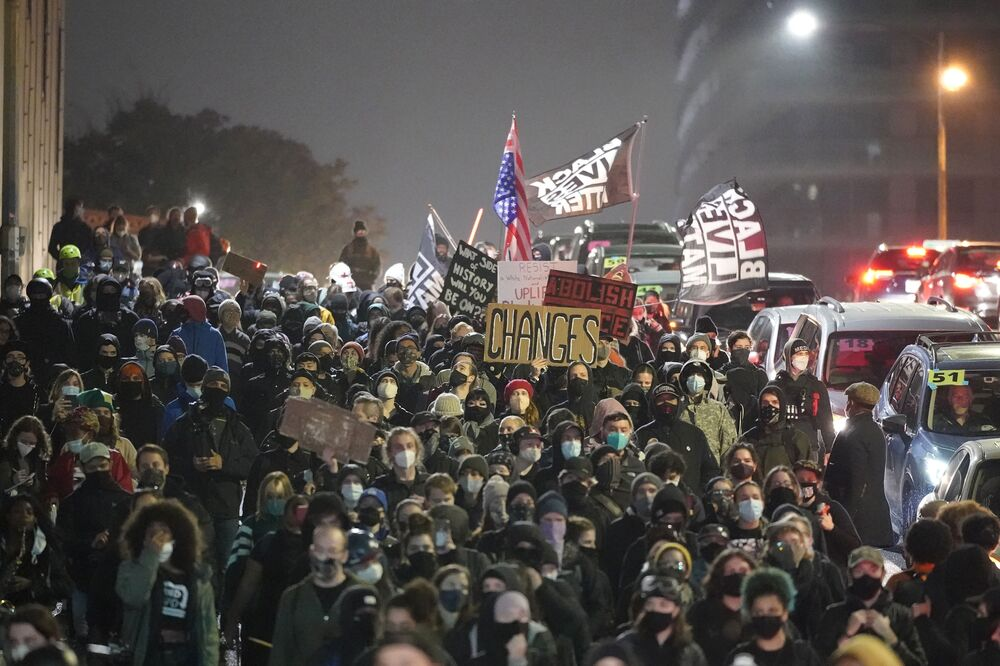 People march on the night of the election in Seattle, Washington, Tuesday 3 November 2020.