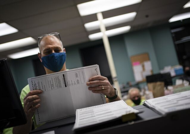 Poll workers sort out early and absentee ballots at the Kenosha Municipal building on Election Day on Tuesday, Nov. 3, 2020, in Kenosha, Wis.