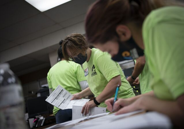 Poll workers sort out early and absentee ballots at the Kenosha Municipal building on Election Day, Tuesday, Nov. 3, 2020, in Kenosha, Wis.