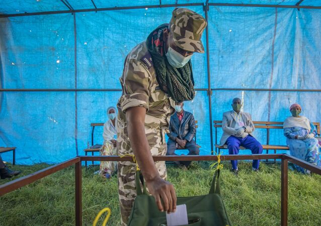 In this Sept. 9, 2020 file photo, a member of Tigray Special Forces casts his vote in a local election in the regional capital Mekelle, in the Tigray region of Ethiopia.