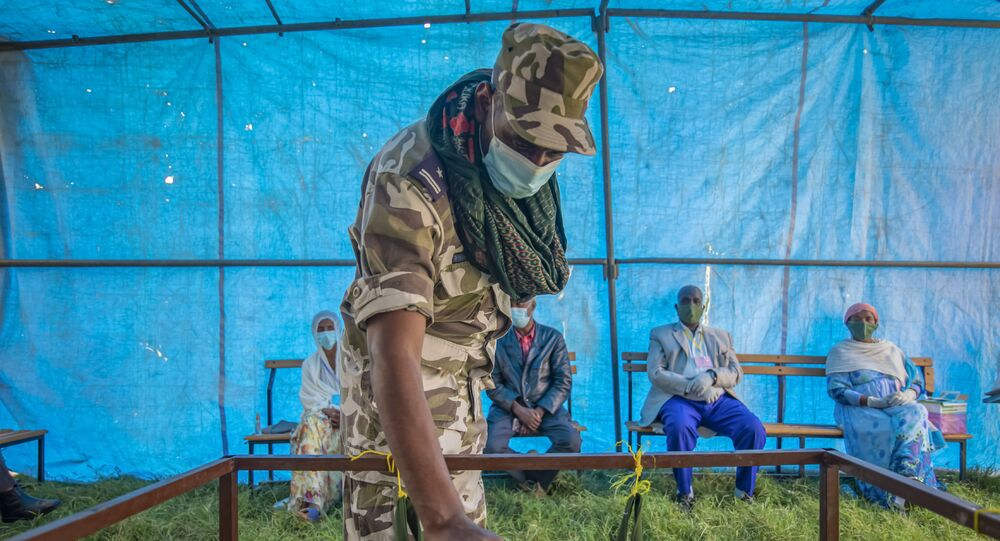 In this 9 September 2020 file photo, a member of Tigray Special Forces casts his vote in a local election in the regional capital Mekelle, in the Tigray region of Ethiopia.
