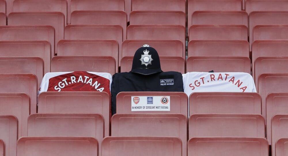 Arsenal shirts with a Metropolitan Police jersey and helmet as a memorial to Sergeant Matt Ratana who was shot dead in September 2020.