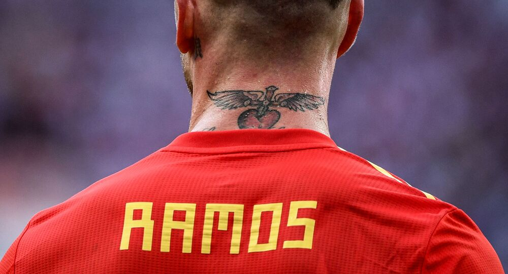 Spain's Sergio Ramos rests during the World Cup Round of 16 soccer match between Spain and Russia at the Luzhniki stadium in Moscow, Russia, July 1, 2018.