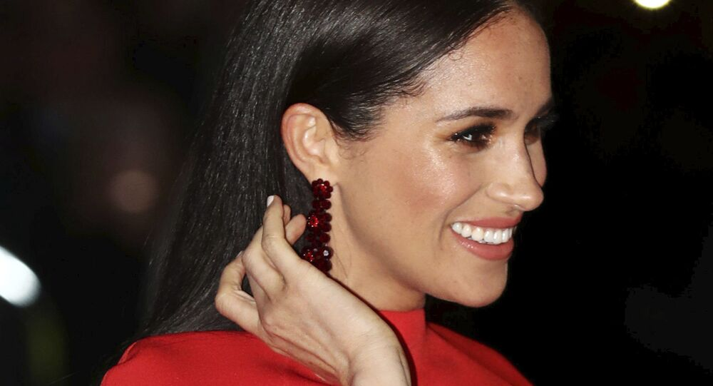 Britain's Meghan, Duchess of Sussex arrives with Prince Harry at the Royal Albert Hall in London, Saturday March 7, 2020, to attend the Mountbatten Festival of Music