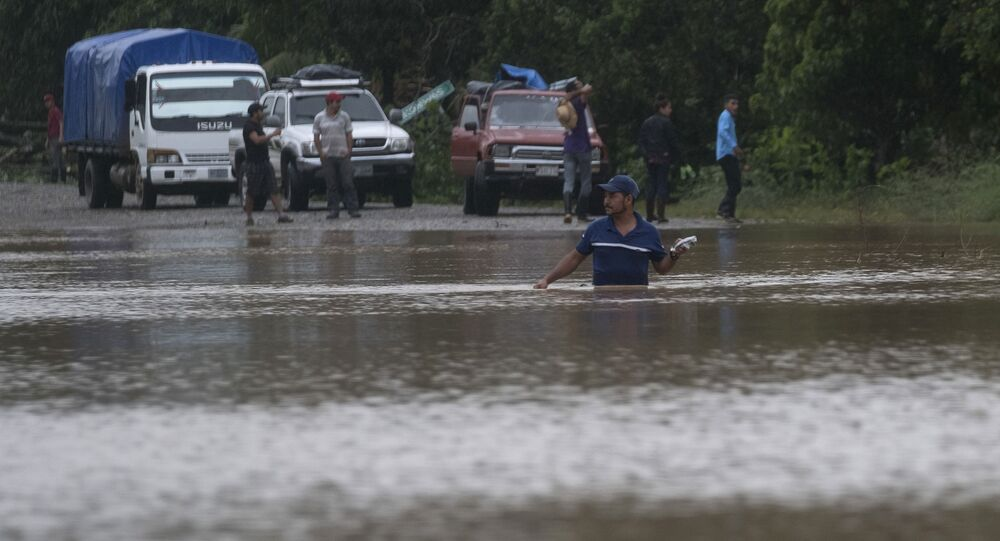 A man walks through a flooded road in Okonwas, Nicaragua, Wednesday, Nov. 4, 2020. Eta weakened from the Category 4 hurricane to a tropical storm after lashing Nicaragua's Caribbean coast for much of Tuesday, its floodwaters isolating already remote communities and setting off deadly landslides.
