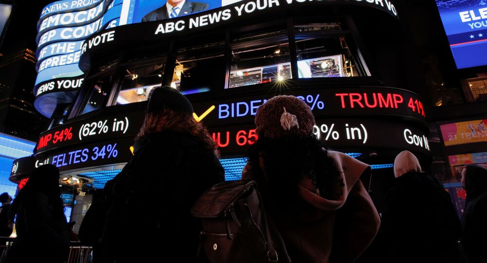 People watch early election results in Times Square in New York City, New York, U.S. November 3, 2020