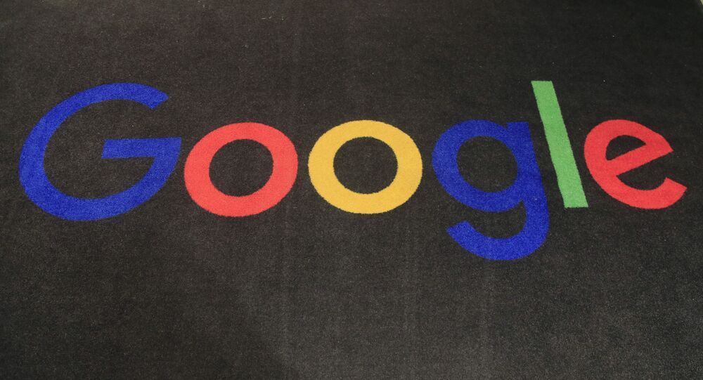 In this 18 November 2019, file photo, the logo of Google is displayed on a carpet at the entrance hall of Google France in Paris.