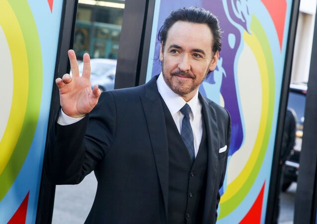 In this June 2, 2015 file photo, actor John Cusack arrives at the premiere of Love & Mercy in Beverly Hills, Calif. Cusack has apologized for tweeting an anti-Semitic cartoon and quotation after initially defending the post, then deleting it.