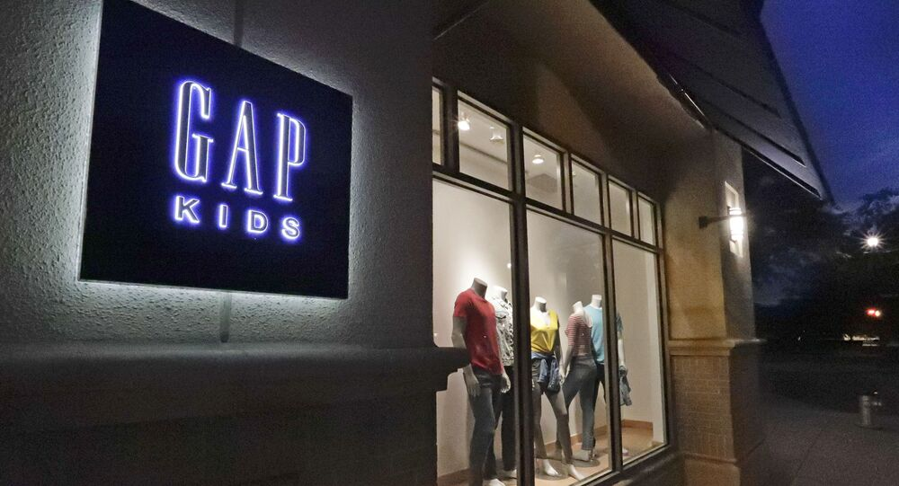 This Aug. 23, 2018, file photo shows a window display at a Gap Kids clothing store in Winter Park, Fla. Gap is moving away from the nation's malls. The brand, which was for decades a fixture at shopping malls around the country, said that it will be closing 220 stores _ or one third of its store base by early 2024 _ and focus on outlet malls and its e-commerce business.