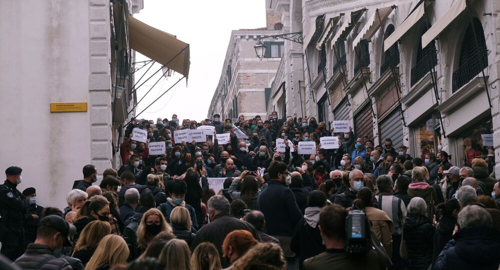 Protesters hold a demonstration against the Italian government's coronavirus disease (COVID-19) restrictions in Venice, Italy, November 3, 2020.