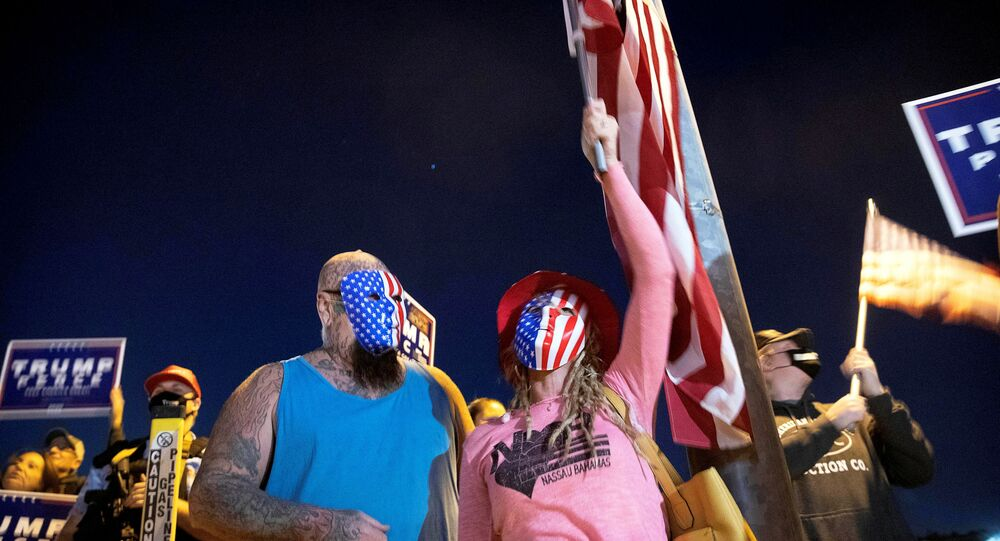 Mike and Wetonia Houlihan join other supporters of U.S. President Donald Trump during a Stop the Steal protest at the Clark County Election Center in North Las Vegas, Nevada, U.S. November 4, 2020.