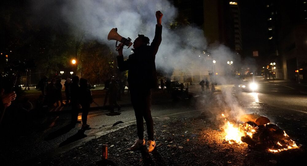 A protester yells after a march to the Mark O. Hatfield United States Courthouse on the night of the election, Tuesday, Nov. 3, 2020, in Portland, Ore.