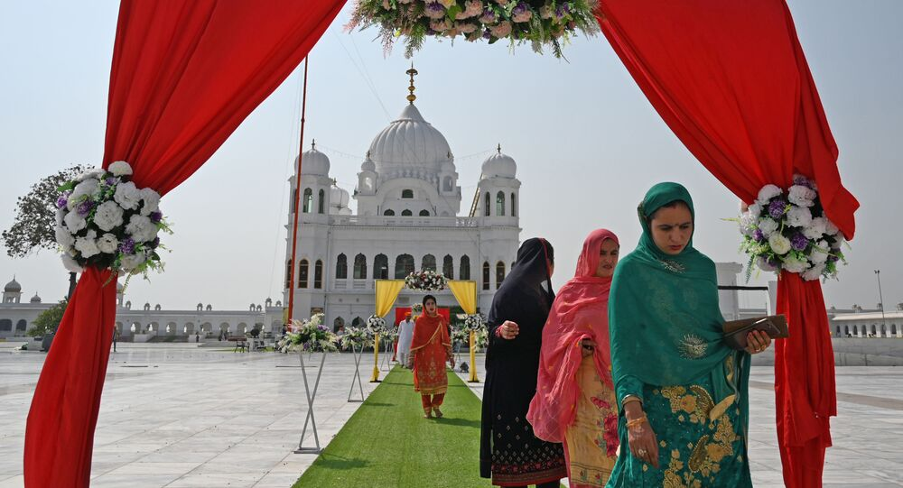 Sikh pilgrims arrive to take part in a religious ritual on the occasion of the 481st anniversary of the death of Baba Guru Nanak Dev Ji, the founder of Sikhism, at the Gurdwara Darbar Sahib in Kartarpur near the India-Pakistan border on 22 September 2020.