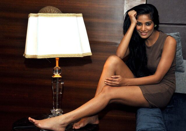 Indian model Poonam Pandey (2011 Kingfisher Calendar girl) poses for a candid photo shoot in Mumbai on 1 June 2012