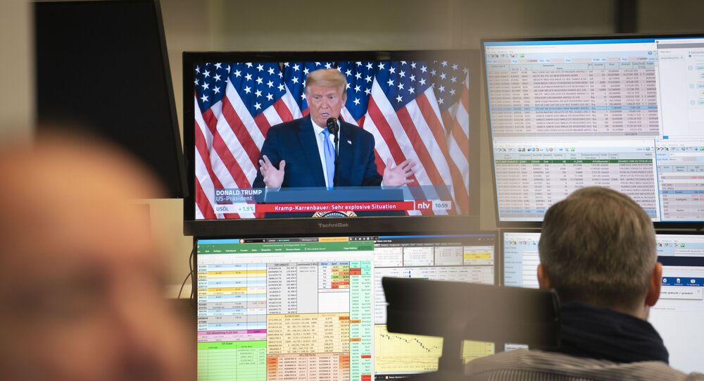 Traders in the Frankfurt Stock Exchange trading room in front of their monitors, which also show reports on the US presidential election on Wednesday, 4 November 2020.