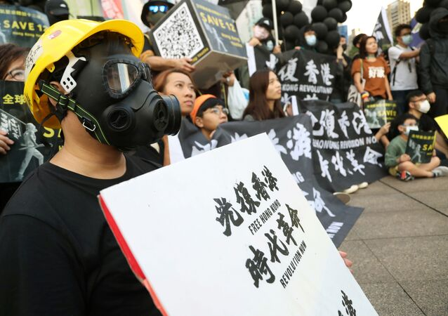 Protesters holding placards attend a rally calling China to release 12 Hong Kong people arrested at sea by mainland authorities, in Taipei