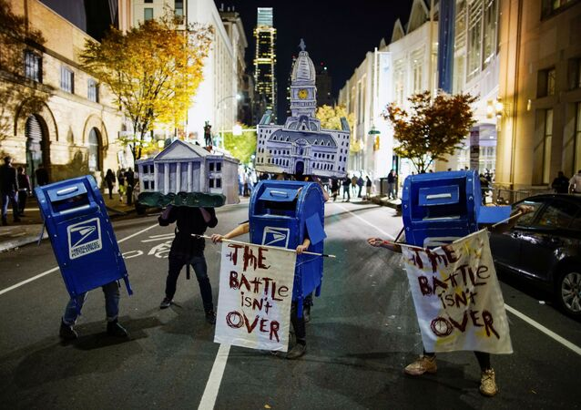 Activists dressed as the White House, Philadelphia City Hall and the United States Postal Service (USPS) mailboxes are pictured on a street two days after the 2020 U.S. presidential election in Philadelphia, Pennsylvania, U.S. November 5, 2020