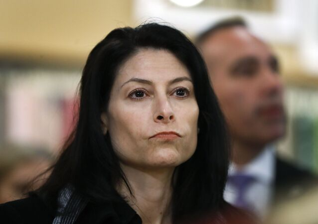 In this 18 March 2019, file photo, Michigan Attorney General Dana Nessel attends an event for Democratic presidential candidate Sen. Kirsten Gillibrand, D-NY, in Clawson, Michigan.