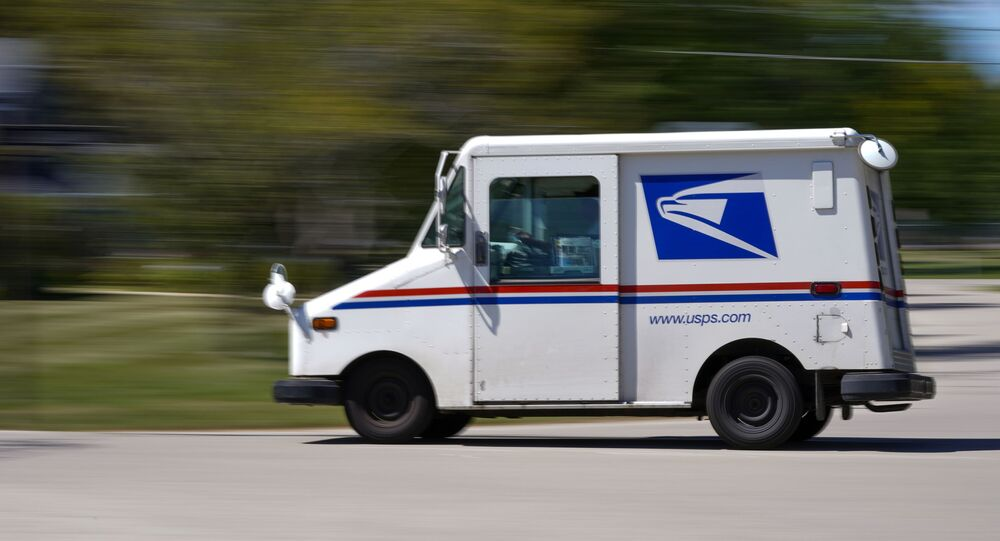 A mail truck moves down a street 18 August 2020, in Fox Point, Wisconsin.