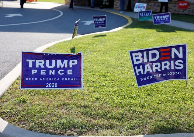 FILE PHOTO: Campaign signs for U.S. President Donald Trump and presidential nominee and former Vice President Joe Biden are seen on Election Day in Cherryville, Pennsylvania, U.S., November 3, 2020
