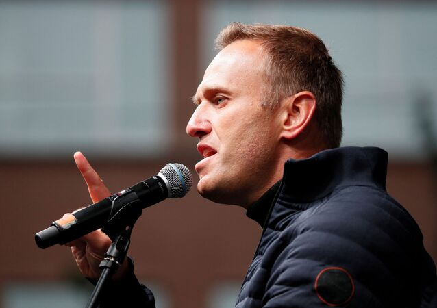 FILE PHOTO: Russian opposition leader Alexei Navalny delivers a speech during a rally to demand the release of jailed protesters, who were detained during opposition demonstrations for fair elections, in Moscow, Russia September 29, 2019