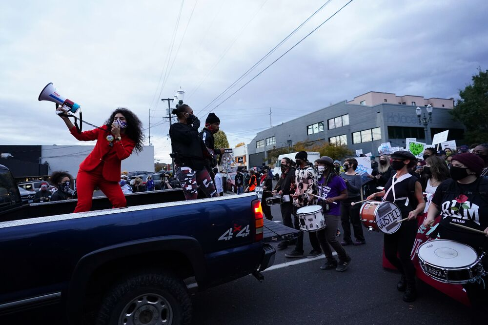 People march during a protest after the 3 November elections, Wednesday, 4 November 2020, in Portland, Oregon.
