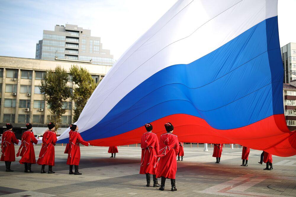 Russian Kuban Cossacks perform a flag-raising ceremony on National Unity Day in Krasnodar, 4 November 2020.