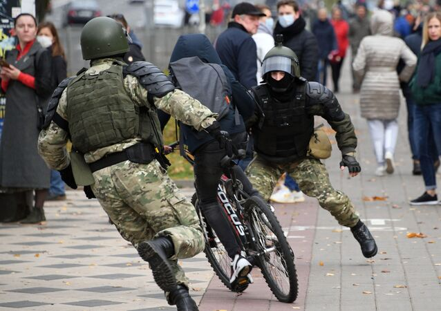 Law enforcement forces trying to stop a bicyclist during an unauthorised rally in Minsk, Belarus.