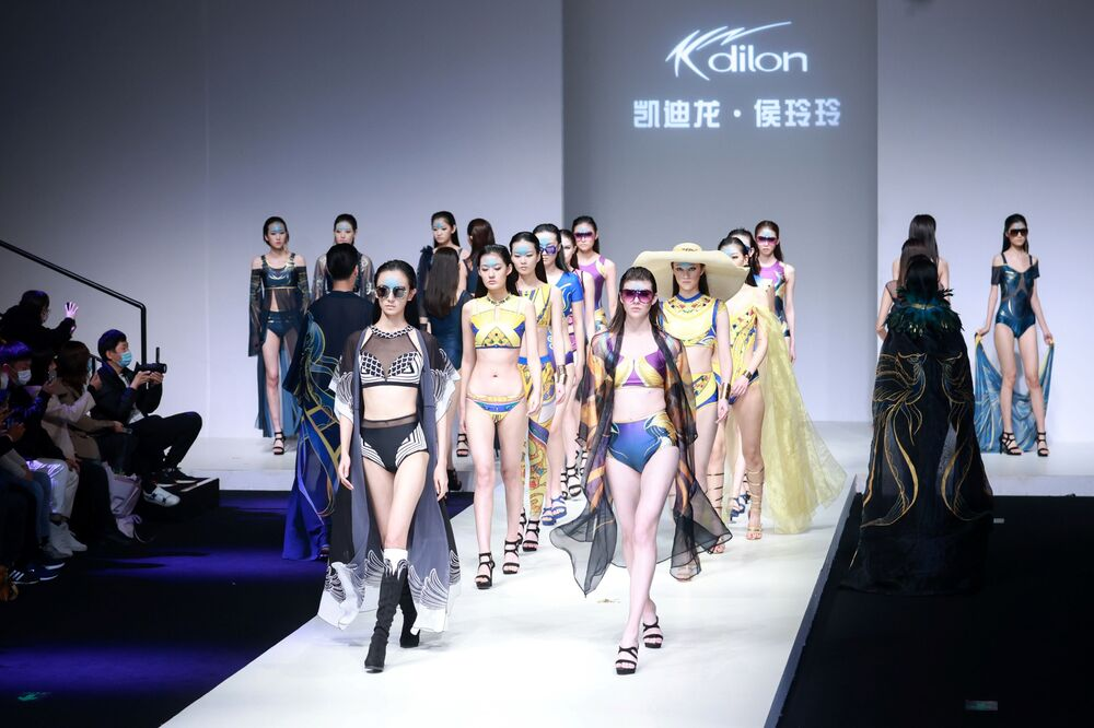 Models parade in creations from the Kdilon collection by Lingling Hou during China Fashion Week in Beijing on 31 October 2020.