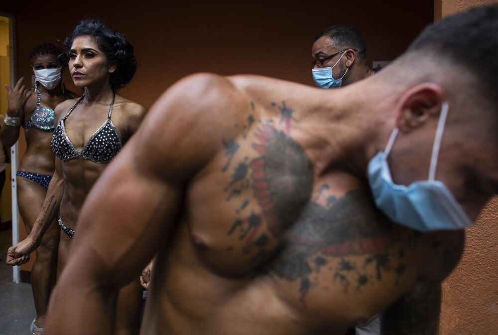 Bodybuilders prepare to participate in the National Bodybuilding Championship in Managua on 31 October 2020, amid the new coronavirus pandemic.