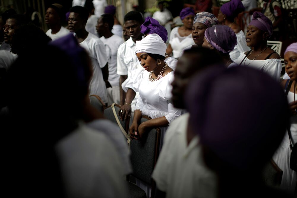 Voodoo practitioners attend a prayer during a two-day 'Fet Gede' ceremony at Lakou Savalouwe in Port-au-Prince, Haiti, 1 November 2020.