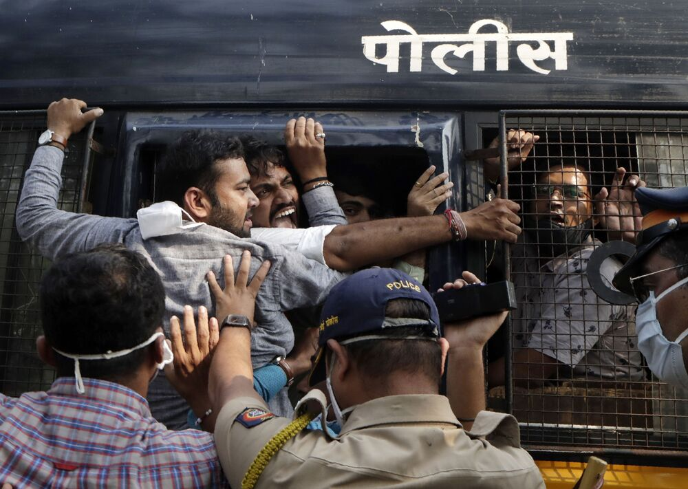 Police detain Bharatiya Janata party workers protesting against the Maharashtra state government for the arrest of television news anchor Arnab Goswami in Mumbai, India, 4 November 2020. Indian police on Wednesday said they arrested the Republic TV founder and charged him with assisting in a suicide in connection with the 2018 deaths of an interior designer and the designer's mother.